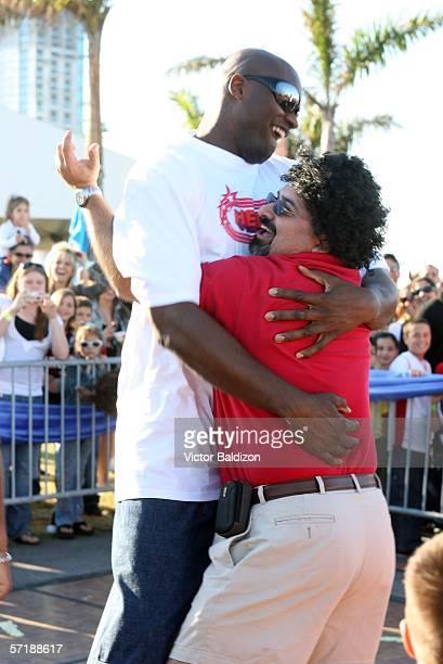 Shaquille O'Neal hugs a contest winner during the Miami Heat Family Festival on March 26 2006 at the American Airlines Arena in Miami Florida NOTE TO...