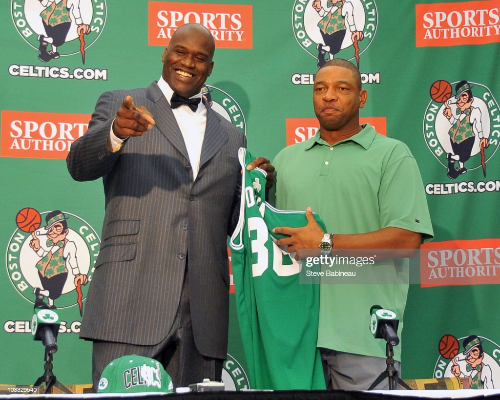 Shaquille O'Neal (L) is introduced as a new member of the Boston Celtics by coach Doc Rivers on August 10, 2010 at the Celtics practice facility in Waltham , Massachusetts. O'Neal was recently acquired by the Celtics for a two-year 2.8 million dollar contract.