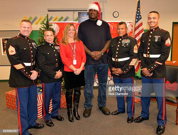 Shaquille O'Neal joined by Teresa Wilhite Toys For Tots Atlanta and Colonel Gregory L Lemons US Marine Corp visits Humphries Elementary School as...