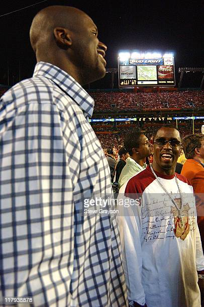 Shaquille O'Neal joins Sean P Diddy Combs on the sidelines of the FedEx Orange Bowl in the third quarter at Pro Player Stadium in Miami Florida on...