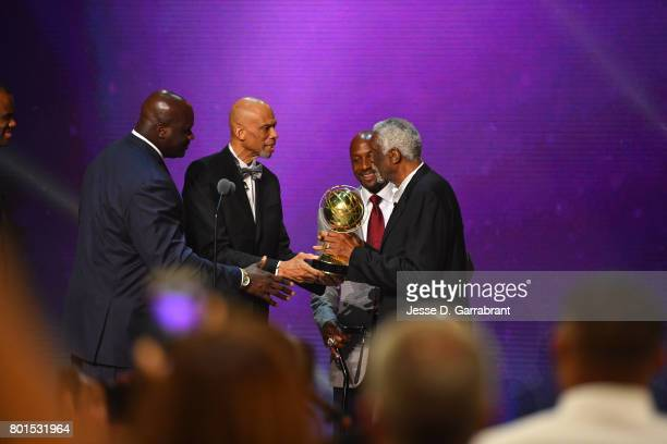 Shaquille O'Neal Kareem AbdulJabbar and Alonzo Mourning presents the Lifetime Achievement Award to Bill Russell during the 2017 NBA Awards Show on...