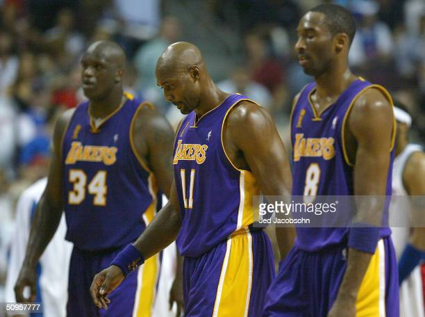Shaquille O'Neal Karl Malone and Kobe Bryant of the Los Angeles Lakers walk off the court in Game Four of the 2004 NBA Finals against the Detroit...