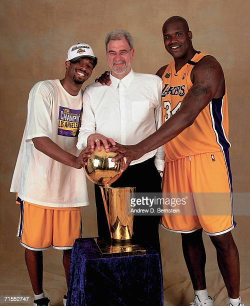Shaquille O'Neal Kobe Bryant of the Los Angeles Lakers and Lakers head coach Phil Jackson pose for a photo after winning the NBA Championship on June...