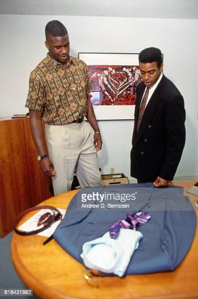 Shaquille O'Neal looks at his suit before the 1992 NBA Draft on June 24 1992 in Portland Oregon NOTE TO USER User expressly acknowledges and agrees...