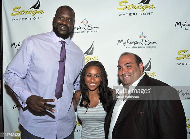 Shaquille O'Neal Nicole Alexander and Nick Varano attend 'SHAQ ATTACK' at Strega Waterfront on June 9 2011 in Boston Massachusetts