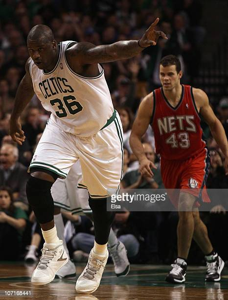 5d2ddbee7bc1 Shaquille O Neal of the Boston Celtics celebrates his basket in the fourth  quarter against