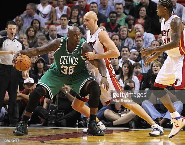 Shaquille O'Neal of the Boston Celtics is guarded by Zydrunas Ilgauskas during a game against the Miami Heat at American Airlines Arena on November...