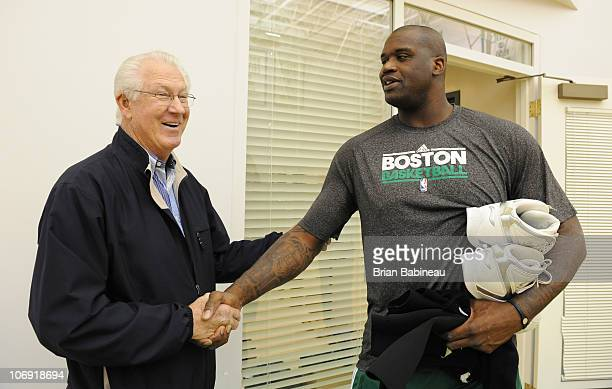 Shaquille O'Neal of the Boston Celtics meets John Havlicek before practice on November 16 2010 at the Boston Sports Club in Waltham Massachusetts...