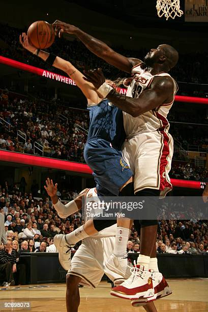 Shaquille O'Neal of the Cleveland Cavaliers blocks a shot attempt by Mike Miller of the Washington Wizards on November 3, 2009 at The Quicken Loans...