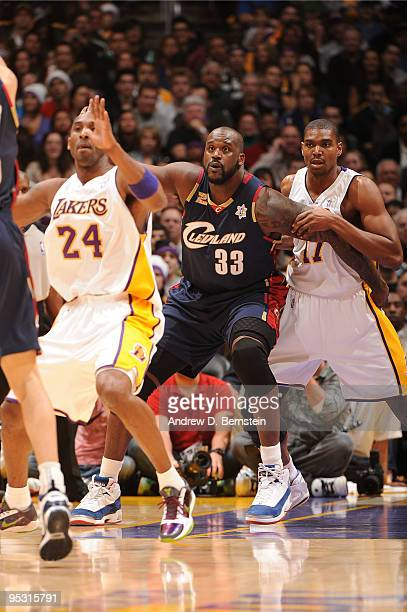 Shaquille O'Neal of the Cleveland Cavaliers calls for the ball in the post between Kobe Bryant and Andrew Bynum of the Los Angeles Lakers at Staples...