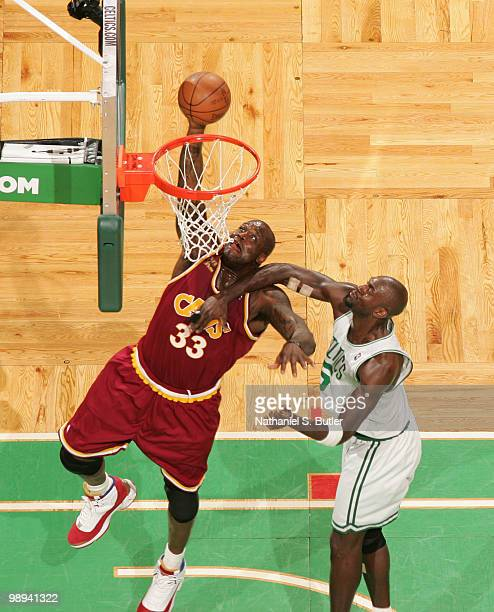 Shaquille O'Neal of the Cleveland Cavaliers dunks against Kevin Garnett of the Boston Celtics in Game Four of the Eastern Conference Semifinals...
