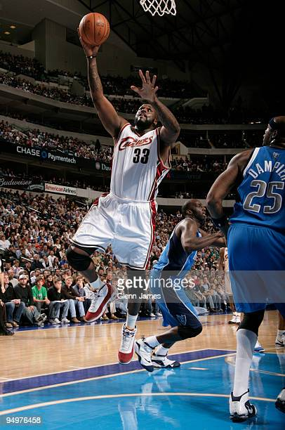 Shaquille O'Neal of the Cleveland Cavaliers gets inside for a layup against Erick Dampier of the Dallas Mavericks during a game at the American...