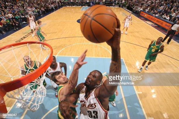 Shaquille O'Neal of the Cleveland Cavaliers goes up for the slam over Mehmet Okur of the Utah Jazz at EnergySolutions Arena on January 14 2010 in...