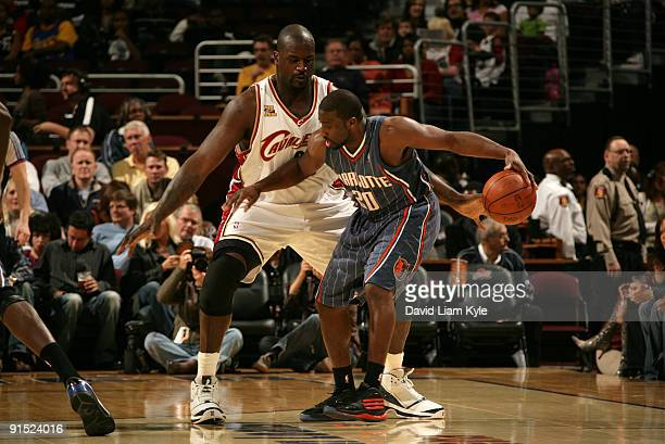 Shaquille O'Neal of the Cleveland Cavaliers guards Raymond Felton of the Charlotte Bobcats at The Quicken Loans Arena on October 6 2009 in...