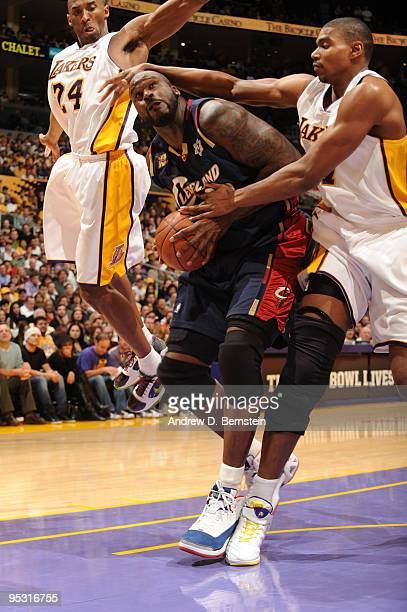 Shaquille O'Neal of the Cleveland Cavaliers is defended by Kobe Bryant and Andrew Bynum of the Los Angeles Lakers at Staples Center on December 25...