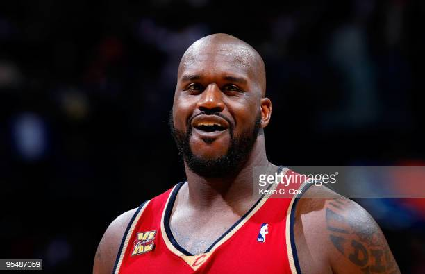 Shaquille O'Neal of the Cleveland Cavaliers laughs after a play against the Atlanta Hawks at Philips Arena on December 29 2009 in Atlanta Georgia...