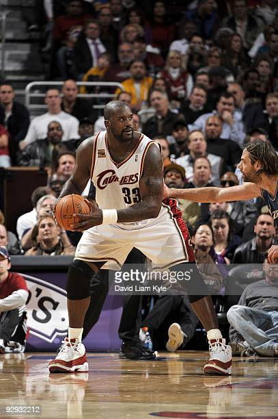 Shaquille O'Neal of the Cleveland Cavaliers looks to make a move against Fabricio Oberto of the Washington Wizards during the game at Quicken Loans...