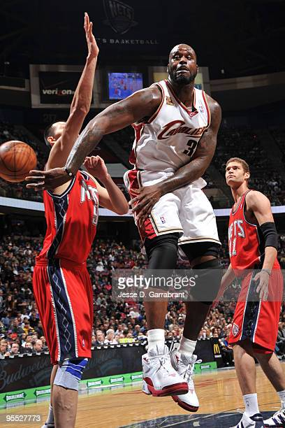 Shaquille O'Neal of the Cleveland Cavaliers passes against Yi Jianlian of the New Jersey Nets during the game on January 2 2010 at the Izod Center in...