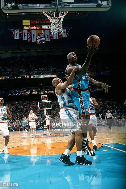 Shaquille O'Neal of the Eastern Conference All Stars gets fouled by Charles Barkley of the Western Conference All Stars during the 1996 NBA All Star...
