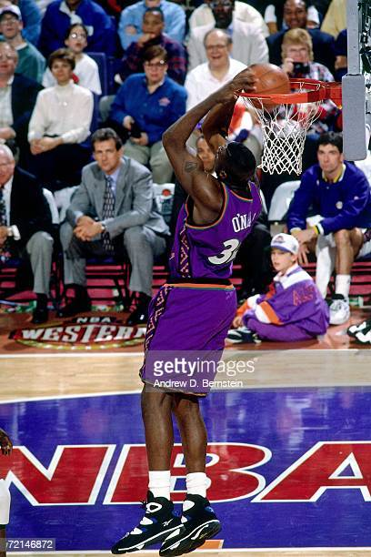 Shaquille O'Neal of the Eastern Conference AllStars elevates for a dunk against the Western Conference AllStars during the 1995 NBA AllStar Game...