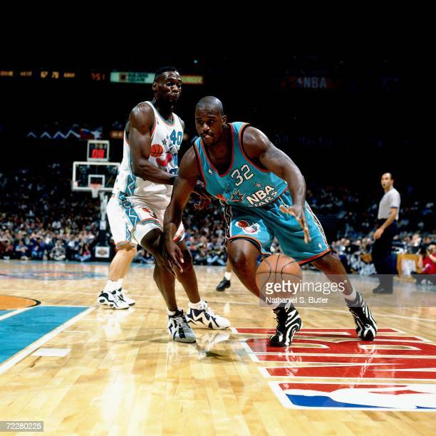 Shaquille O'Neal of the Eastern Conference AllStars makes a move against Shawn Kemp of the Western Conference AllStars during the 1996 NBA AllStar...