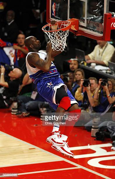 Shaquille O'Neal of the Eastern Conference hangs on the rim after dunking against the Western Conference during the 2006 NBA AllStar Game February 19...