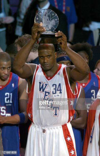 Shaquille O'Neal of the Los Angeles Lakers accepts the most valuable player trophy after scoring 24 points and grabbing 11 rebounds during the NBA...