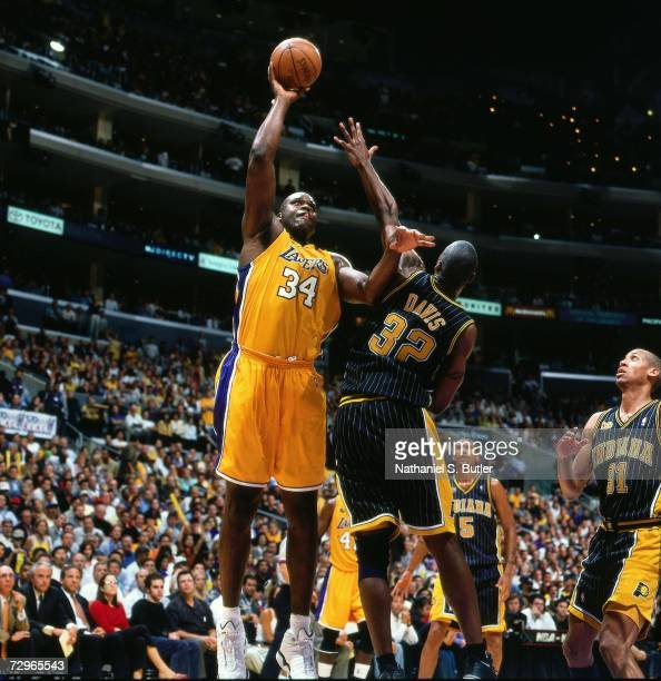 Shaquille O'Neal of the Los Angeles Lakers attempts a shot against Dale Davis of the Indiana Pacers during Game Six of the 2000 NBA Finals on June 19...