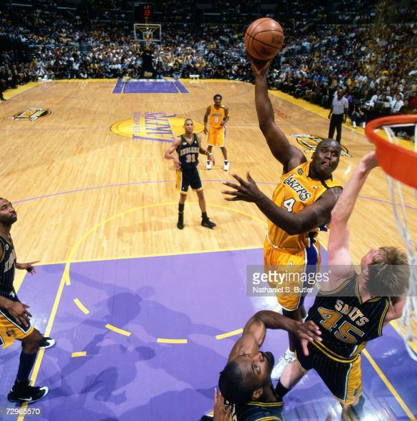 Shaquille O'Neal of the Los Angeles Lakers attempts a shot against Rick Smits of the Indiana Pacers during Game Six of the 2000 NBA Finals on June 19...