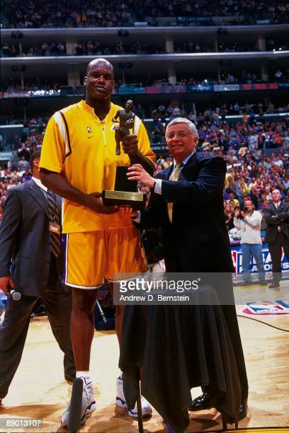 Shaquille O'Neal of the Los Angeles Lakers, awarded Most Vauable Player, poses with the Maurice Podoloff Trophy and David Stern prior to Game Two of...
