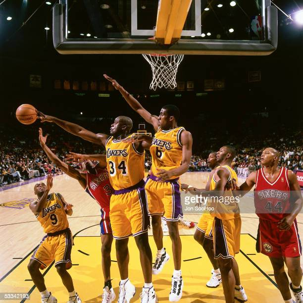 Shaquille O'Neal of the Los Angeles Lakers blocks a shot by Allen Iverson of the Philadelphia 76ers during an NBA game circa 1997 at the Forum in Los...