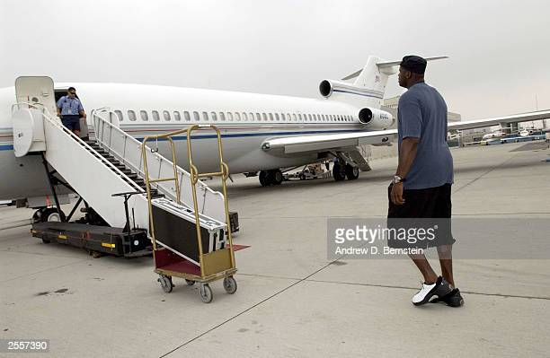 Shaquille O'Neal of the Los Angeles Lakers boards a plane headed for training camp in Honolulu Hawaii October 2 2003 in Los Angeles California NOTE...