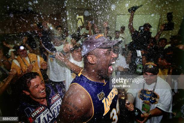Shaquille O'Neal of the Los Angeles Lakers celebrates in the locker room after winning the 2001 NBA Championship against the Philadelphia 76'ers...