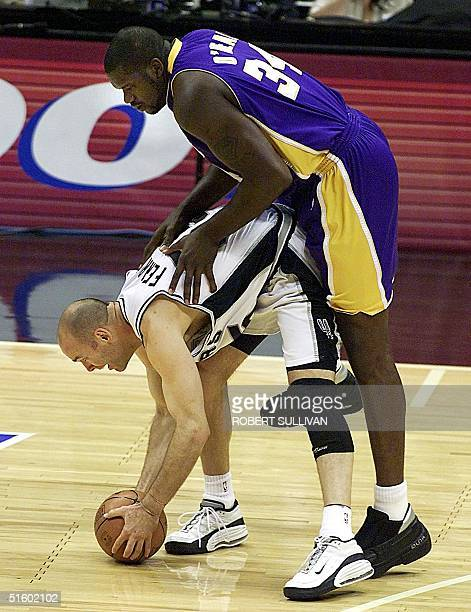 Shaquille O'Neal of the Los Angeles Lakers collides with Danny Ferry of the San Antonio Spurs and is called for a foul during game 2 of the NBA...