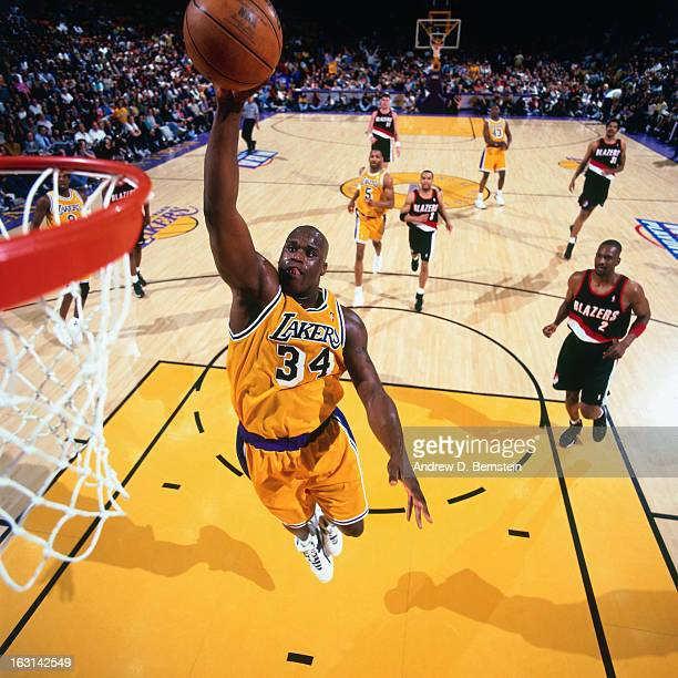 Shaquille O'Neal of the Los Angeles Lakers dunks against the Portland Trail Blazers in Game One of the Western Conference Quarterifinals as part of...