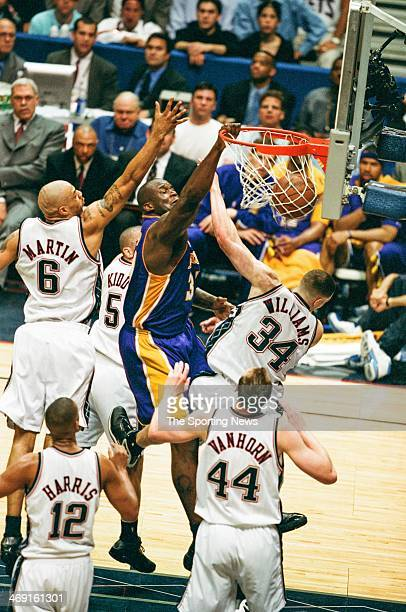 Shaquille O'Neal of the Los Angeles Lakers dunks during Game Four of the NBA Finals against the New Jersey Nets on June 12 2002 at Continental...