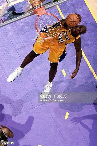 Shaquille O'Neal of the Los Angeles Lakers elevates for a dunk against the Indiana Pacers during Game One of the 2000 NBA Finals played June 7 2000...