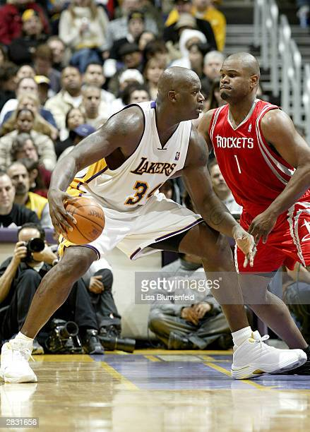 Shaquille O'Neal of the Los Angeles Lakers goes to the basket defended by Alton Ford of the Houston Rockets on December 25 2003 at the Staples Center...