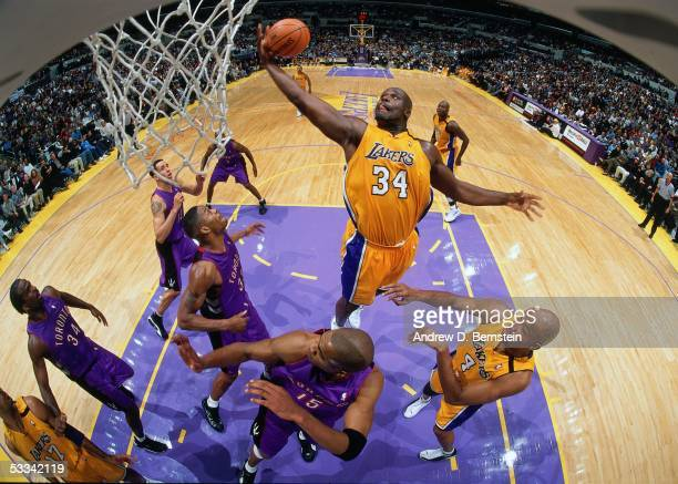 Shaquille O'Neal of the Los Angeles Lakers grabs a rebound against the Toronto Raptors during an NBA game circa 2000 at the Staples Center in Los...