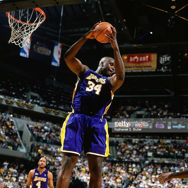 Shaquille O'Neal of the Los Angeles Lakers grabs a rebound against the Indiana Pacers during Game Four of the 2000 NBA Finals on June 14 2000 at...
