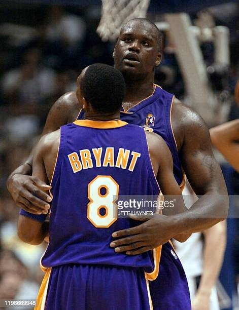 Shaquille O'Neal of the Los Angeles Lakers hugs teammate Kobe Bryant during the first half in game four of the NBA Finals against the New Jersey Nets...