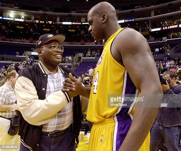 Shaquille O'Neal of the Los Angeles Lakers is congratulated by his father Philip Harrison after the Lakers defeated the Portland Trail Blazers 10688...