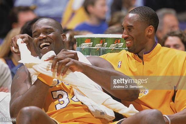 Shaquille O'Neal of the Los Angeles Lakers laughs with Kobe Bryant during the game against the Cleveland Cavaliers at Staples Center on January 10...