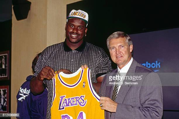 Shaquille O'Neal of the Los Angeles Lakers poses with Jerry West as he signs with the team during a press conference on July 19 1996 at the Great...