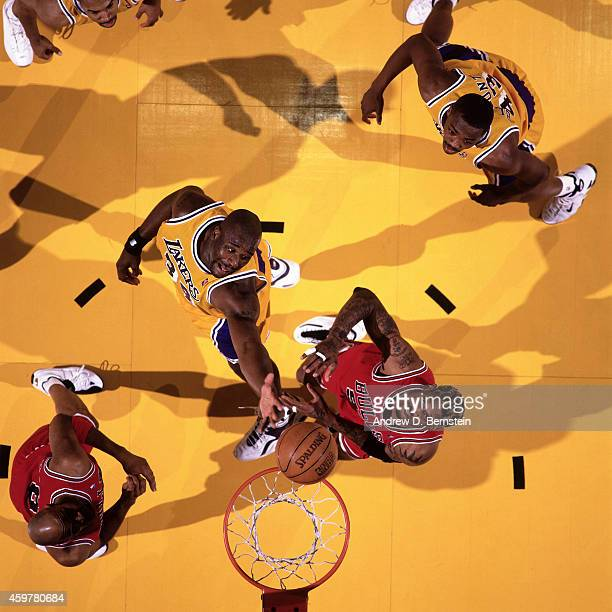 Shaquille O'Neal of the Los Angeles Lakers rebounds against Dennis Rodman of the Chicago Bulls on February 1 1998 at The Forum in Inglewood...