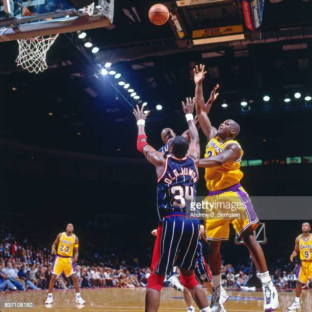 Shaquille O'Neal of the Los Angeles Lakers shoots against the Houston Rockets on October 22 1996 at the Great Western Forum in Inglewood California...