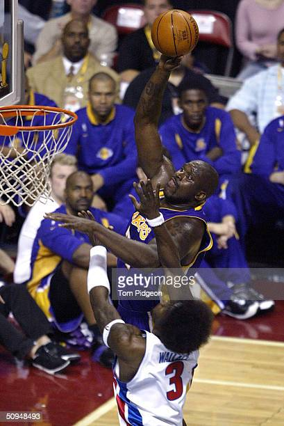 Shaquille O'Neal of the Los Angeles Lakers shoots over Ben Wallace of the Detroit Pistons in game three of the 2004 NBA Finals on June 10, 2004 at...