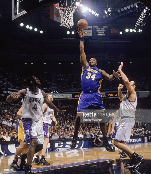 Shaquille O'Neal of the Los Angeles Lakers shoots the ball over Vlade Divac of the Sacramento Kings during game 2 of the Western Conference Finals...