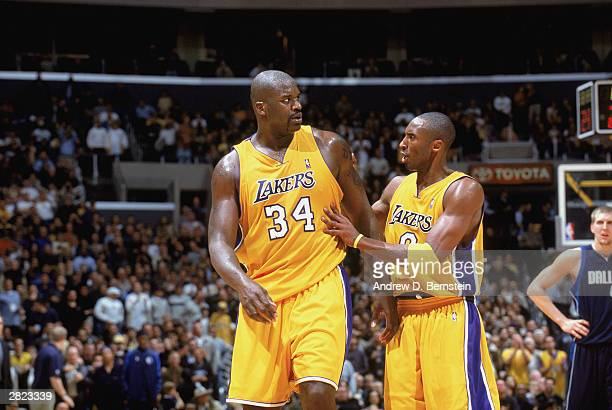 Shaquille O'Neal of the Los Angeles Lakers talks to his teammate Kobe Bryant during the game against the Dallas Mavericks at Staples Center on...