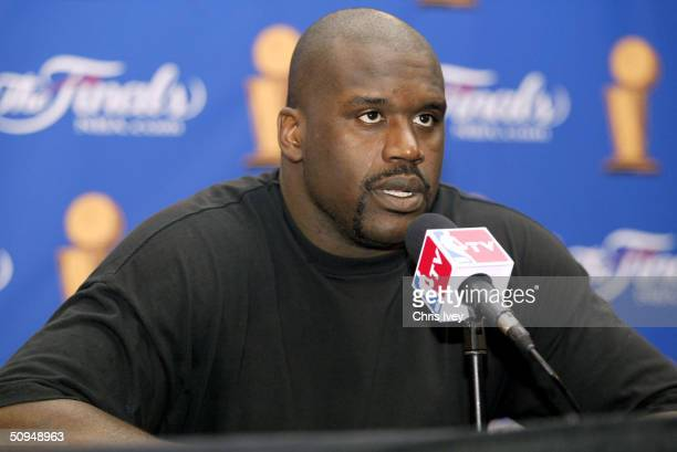 Shaquille O'Neal of the Los Angeles Lakers talks to the media following the Lakers' 88-68 loss to the Detroit Pistons in game three of the 2004 NBA...